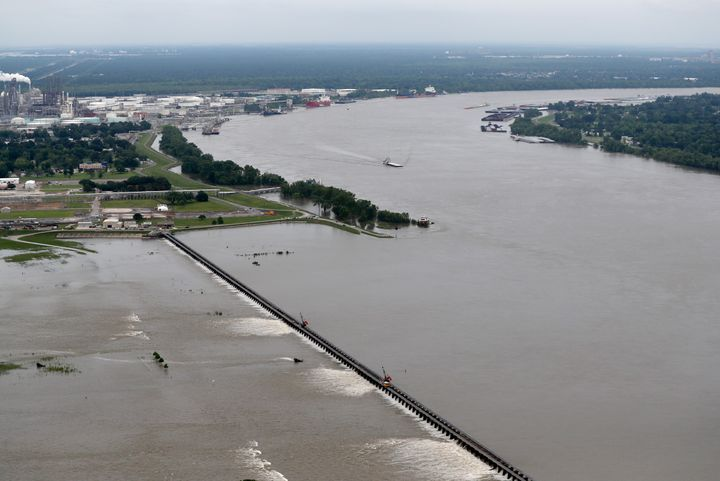 Workers open bays of the Bonnet Carre Spillway to divert rising water from the Mississippi River to Lake Pontchartrain, upriv