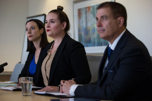 Angela Bespflug, centre, a lawyer for the plaintiffs sits with Janelle O'Connor, back left, and Patrick...