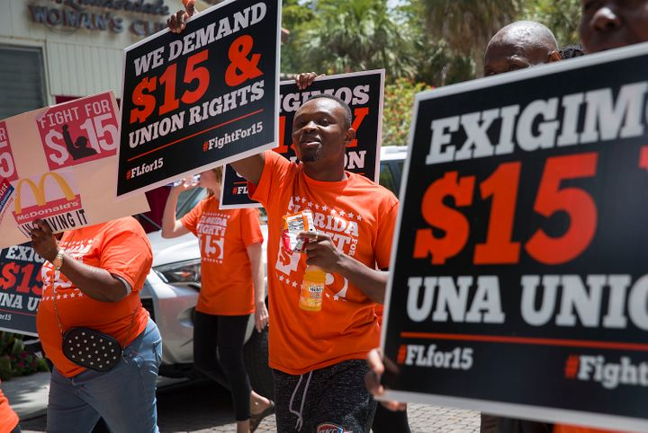 After pursuing more moderate minimum wage increases for years, Democrats have gradually rallied around $15 as their number, b