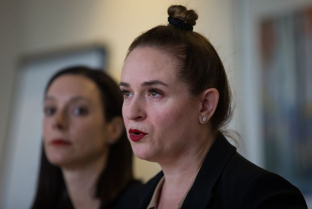 Angela Bespflug, speaks about a settlement as lawyer Janelle O'Connor, back, listens in Vancouver, on...
