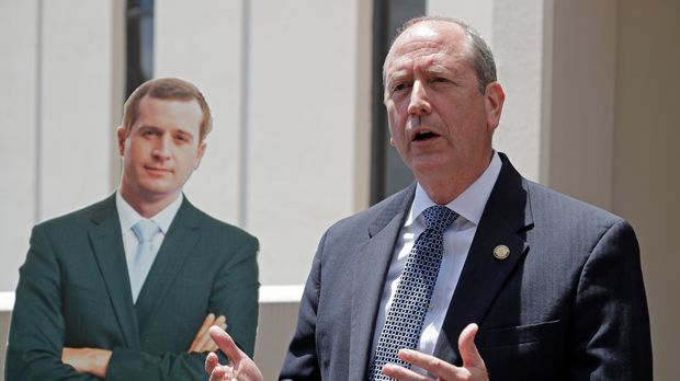 Ninth Congressional district Republican candidate State Sen. Dan Bishop speaks beside a cutout of Democratic challenger Dan McCready during a news conference outside McCready's campaign headquarters in Charlotte, N.C., Wednesday, May 15, 2019. Bishop faces McCready, as well as Libertarian and Green candidates, on Sept. 10. (AP Photo/Chuck Burton)