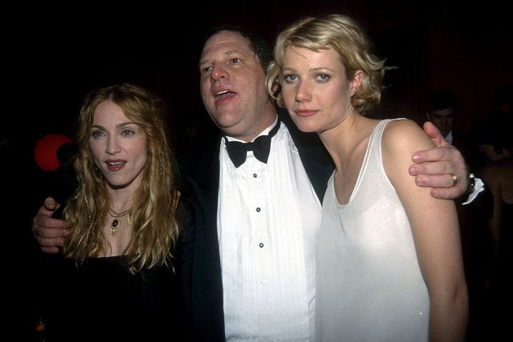 Gwyneth Paltrow's face says it all. The actress is pictured here with Harvey Weinstein and Madonna at the 1998 Golden Globes.