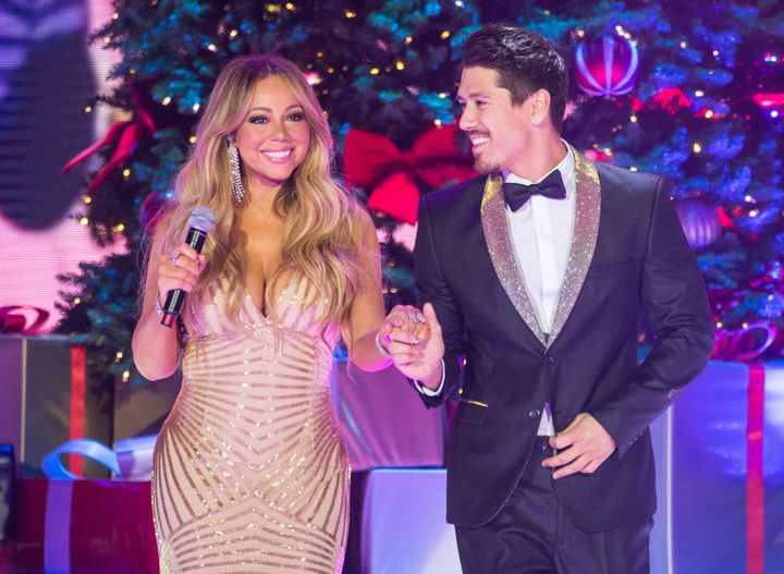 Mariah Carey and Bryan Tanaka perform live on stage at the O2 Arena on Dec.11, 2017, in London, England