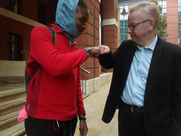 Chadwick Jackson engaging a friendly fist bump, or 'spud', with Michael Gove -Secretary of State...