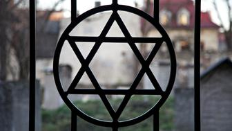 Judaism symbol. Jewish Star of David. Jude Cemetery in Cracow Ghetto. Kazimierz district. Poland. Auschwitz and Holocaust metaphor.