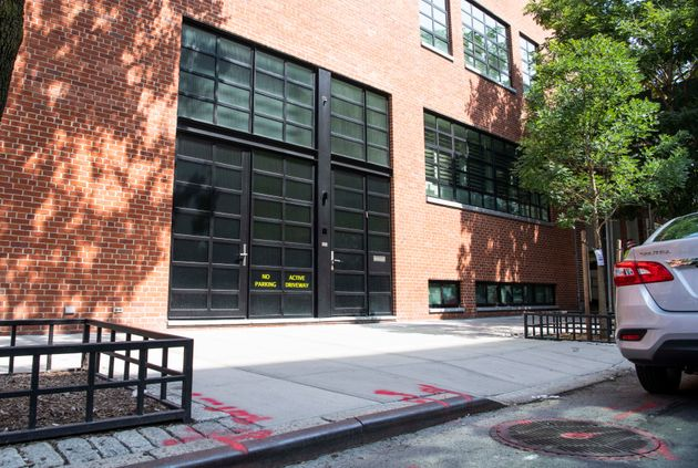 Noam Gottesman's compound shows a sidewalk curb has been whittled down to form a driveway ― and perhaps...