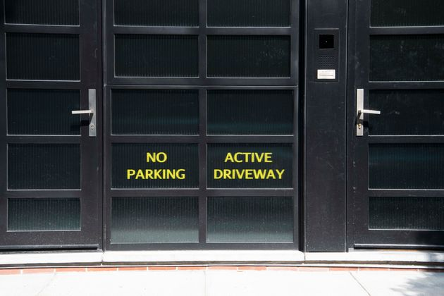 Signs on the back entrance to Noam Gottesman's complex read
