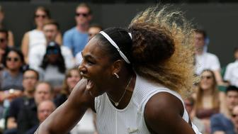 United States' Serena Williams returns the ball to United States' Alison Riske during a women's quarterfinal match on day eight of the Wimbledon Tennis Championships in London, Tuesday, July 9, 2019. (AP Photo/Kirsty Wigglesworth)
