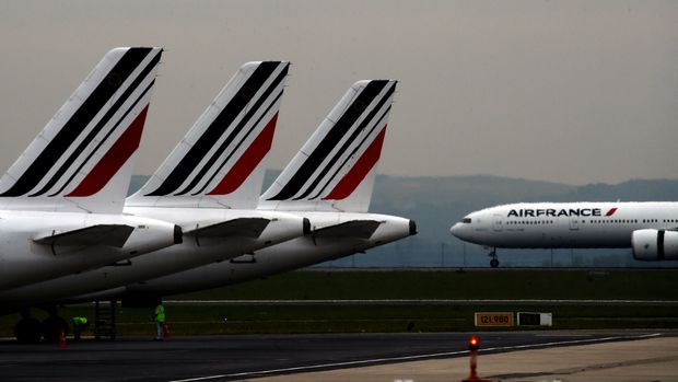 "FILE - In this May 17, 2019 file photo, Air France planes are parked on the tarmac at Paris Charles de Gaulle airport, in Roissy, near Paris. The French government will implement an ""ecotax"" on plane tickets for flights departing from France from next year, the government said Tuesday July 9, 2019. The tax is expected to raise over 180 million euros ($200 million) from 2020 to invest in eco-friendly transport infrastructure, including rail. (AP Photo/Christophe Ena, File)"