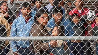 "Migrants are gathered inside the fence of a makeshift detention center in El Paso, Texas on Wed. March 27, 2019. Border Patrol in El Paso is saying that they are overwhelmed with unprecedented number of migrants at over 12,000 currently in custody. Kevin McAleenan, the commissioner of U.S. Customs and Border Protection is calling the situation at the El Paso border a ""crisis"" and asking for Congressional assistance. (Photo by Sergio Flores for The Washington Post via Getty Images)"