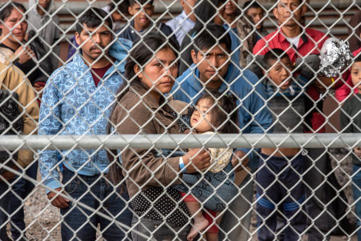 <strong>D</strong>Migrants are gathered inside the fence of a makeshift detention center in El Paso, Texas on Wed. March 27,