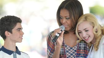 WASHINGTON, DC - APRIL 21:  (AFP OUT) Comedian Peyton List (R) and Cameron Boyce(L) from the comedy series Jessie makes a healthy drink with First Lady Michelle Obama during the annual White House Easter Egg Roll on the South Lawn of the White House April 21, 2014 in Washington, DC. President Barack Obama and first lady Michelle Obama hosted thousands of people during the annual celebration of Easter. (Photo by Olivier Douliery-Pool/Getty Images)