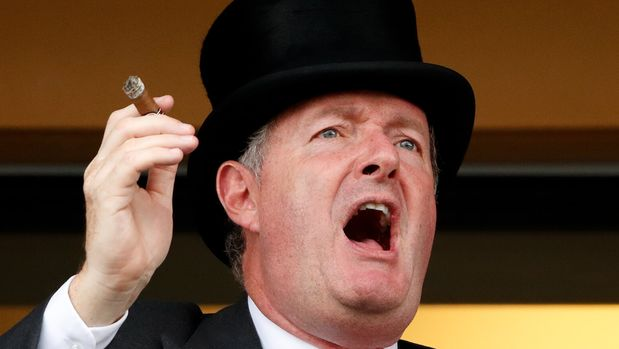 ASCOT, UNITED KINGDOM - JUNE 19: (EMBARGOED FOR PUBLICATION IN UK NEWSPAPERS UNTIL 24 HOURS AFTER CREATE DATE AND TIME) Piers Morgan smokes a cigar whilst watching the racing on day two of Royal Ascot at Ascot Racecourse on June 19, 2019 in Ascot, England. (Photo by Max Mumby/Indigo/Getty Images)
