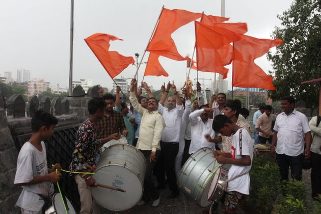 Maratha community members celebrate after Bombay High Court upheld the community's reservation last