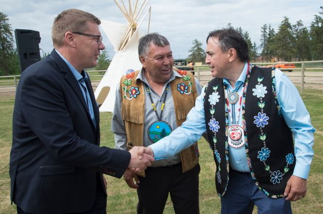 Saskatchewan Premier Scott Moe, left, shakes hands with Assembly of First Nations National Chief Perry...
