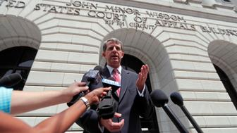 "Robert Henneke, general counsel and director for the Center for the American Future, speaks to reporters outside the 5th Circuit Court of Appeals after arguments in New Orleans, Tuesday, July 9, 2019. The appeals court heard arguments today on whether President Barack Obama's signature health care law known as ""Obamacare"" is still valid after Congress zeroed out the tax people had to pay who didn't have insurance. (AP Photo/Gerald Herbert)"