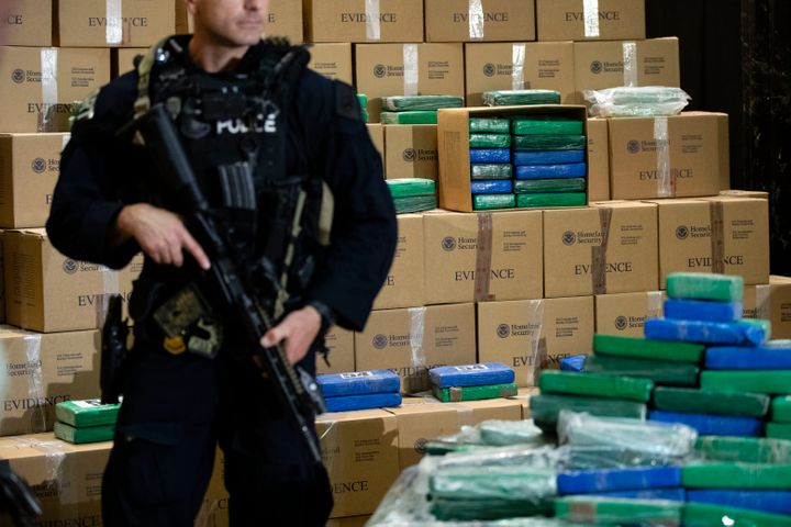 An officer stands guard over some of the cocaine seized from a ship at the Port of Philadelphia.