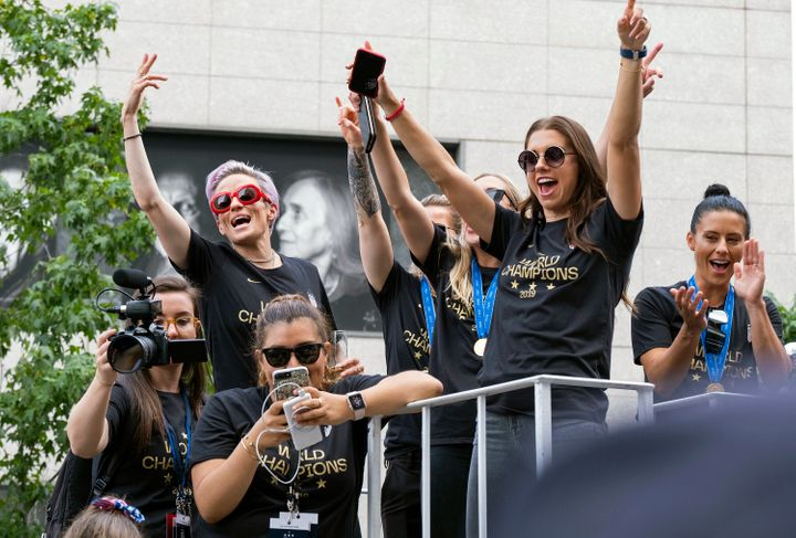 Member of the U.S. women's soccer team, including Megan Rapinoe, rear left, and Alex Morgan, right foreground, stand on a flo