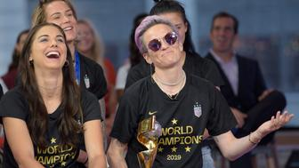 "GOOD MORNING AMERICA - 7/9/19 The United States Women's National Soccer Team celebrate their victory on ""Good Morning America,"" Tuesday, July 9, 2019 on the Walt Disney Television Network.   GMA19(Photo by Paula Lobo/Walt Disney Television via Getty Images) ALEX MORGAN, MEGAN RAPINOE"