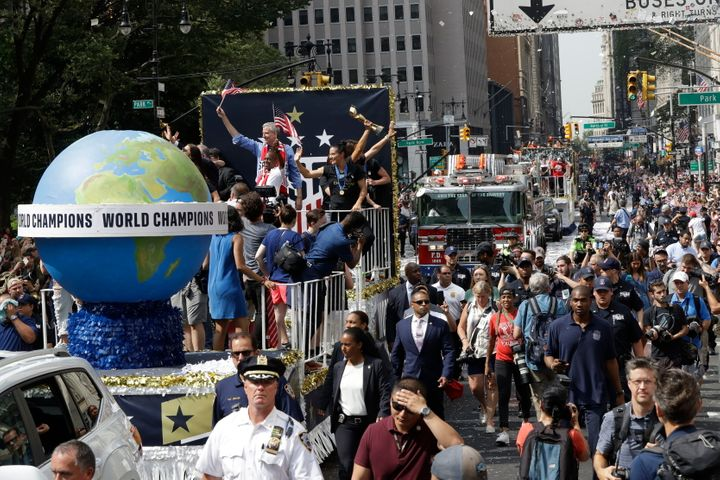A float with members of the U.S. women's soccer team and New York Mayor Bill de Blasio, rear, makes its way up Broadway in a