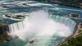 NIAGARA FALLS, ONTARIO, CANADA - 2019/06/28: Aerial view of Horseshoe Fall of the Niagara Falls is seen on a hot and sunny day. Niagara Falls is the collective name for three waterfalls - a Horseshoe Fall, an American Falls and a Bridal Veil Falls which is straddle the international border between Canada and the United States; more specifically, between the province of Ontario and the state of New York. (Photo by Dinendra Haria/SOPA Images/LightRocket via Getty Images)