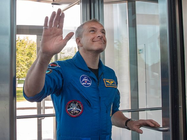 Canadian astronaut David Saint-Jacques waves to colleagues Wednesday as he arrives at the Canadian Space...
