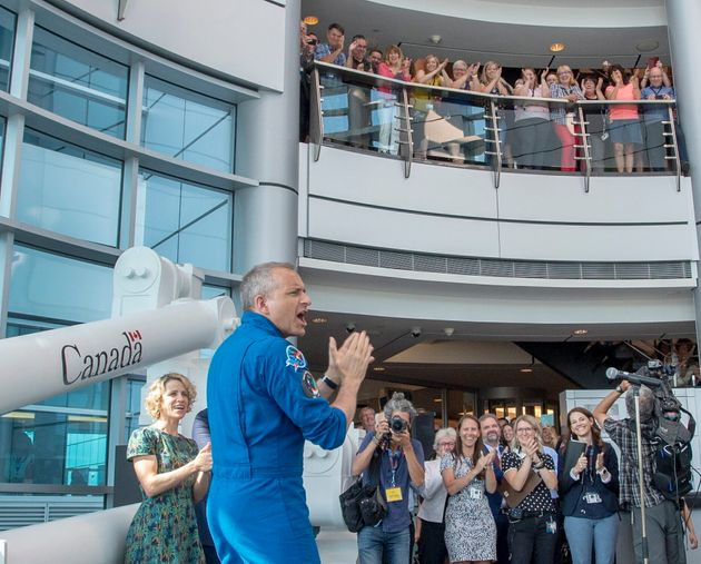 Canadian astronaut David Saint-Jacques receives a thunderous applause at the Canadian Space Agency headquarters...