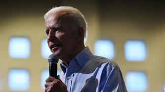 Democratic presidential candidate and former Vice President Joe Biden speaks at a town hall on Sunday, July 7, 2019, in Charleston, S.C., as state Sen. Marlon Kimpson looks on. (AP Photo/Meg Kinnard)