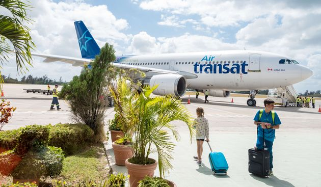Passengers preparing to board an Air Transat jet leaving Cuba, Feb. 19,
