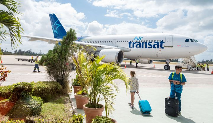 Passengers preparing to board an Air Transat jet leaving Cuba, Feb. 19, 2016.