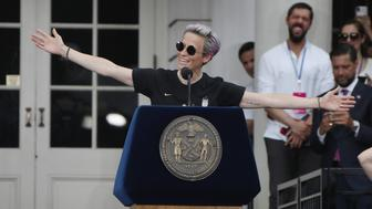"NEW YORK, NEW YORK - JULY 10: Megan Rapinoe and members of the United States Women's National Soccer Team are honored at a ceremony at City Hall on July 10, 2019 in New York City. The honor followed a ticker tape parade up lower Manhattan's ""Canyon of Heroes"" to celebrate their gold medal victory in the 2019 Women's World Cup in France. (Photo by Bruce Bennett/Getty Images)"