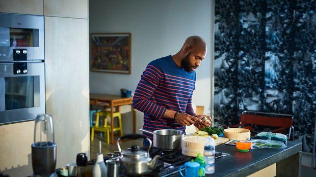 Man preparing baby food in kitchen