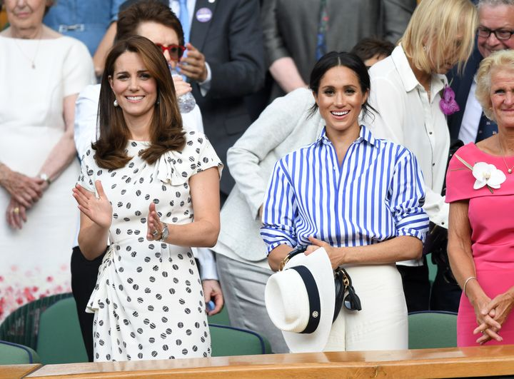 Kate and Meghan at the Wimbledon Tennis Championships at the All England Lawn Tennis and Croquet Club on July 14, 2018.