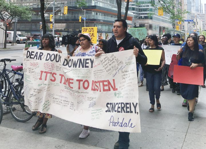 Protestors gathered outside of the Ministry of the Attorney General on Tuesday to speak out against cuts to Legal Aid Ontario.
