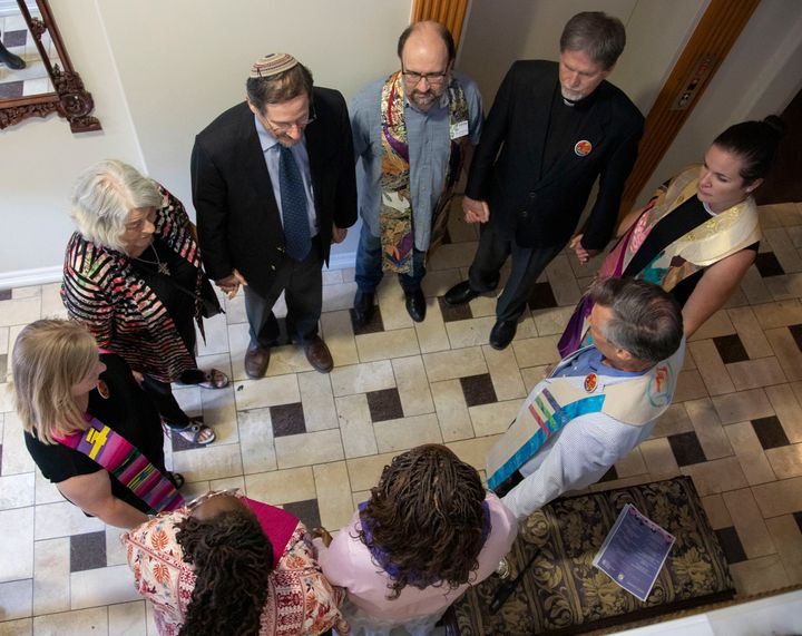 Clergy from several faiths gather to offer a blessing on July 9, 2019, at Whole Woman's Health of Austin, Texas, which