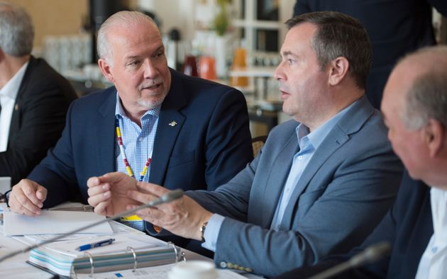 British Columbia Premier John Horgan speaks with Alberta Premier Jason Kenney during a meeting of Canada's...