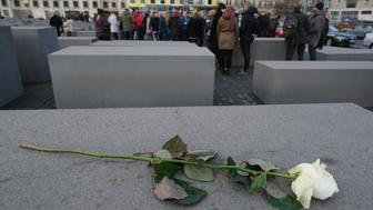 "BERLIN, GERMANY - JANUARY 29: A white rose lies on one of the hundreds of stellae at the Memorial to the Murdered Jews of Europe, also called the Holocaust Memorial, during a visit by German high school students on January 29, 2019 in Berlin, Germany. Students from across Germany are participating in the program called ""Youth Commemorates"" (""Jugend Erinnert""), which for many also included a trip to the Auschwitz concentration camp memorial. Recent studies have found that a significant percentage of young people, especially in eastern Germany, have an inadequate knowledge of the Holocaust.  (Photo by Sean Gallup/Getty Images)"