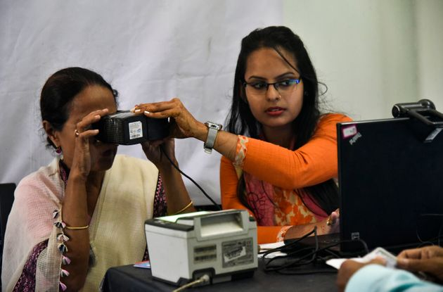 A woman scanning her eyes at an Aadhar registration office in Guwahati on 8 October