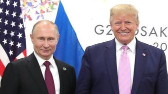 "OSAKA, JAPAN - JUNE 28: (----EDITORIAL USE ONLY  MANDATORY CREDIT - ""KREMLIN PRESS OFFICE  / HANDOUT"" - NO MARKETING NO ADVERTISING CAMPAIGNS - DISTRIBUTED AS A SERVICE TO CLIENTS----) US President Donald Trump (R) meets Russian President Vladimir Putin (L) on the first day of the G20 summit in Osaka, Japan on June 28, 2019. (Photo by Kremlin Press Office / Handout/Anadolu Agency/Getty Images)"