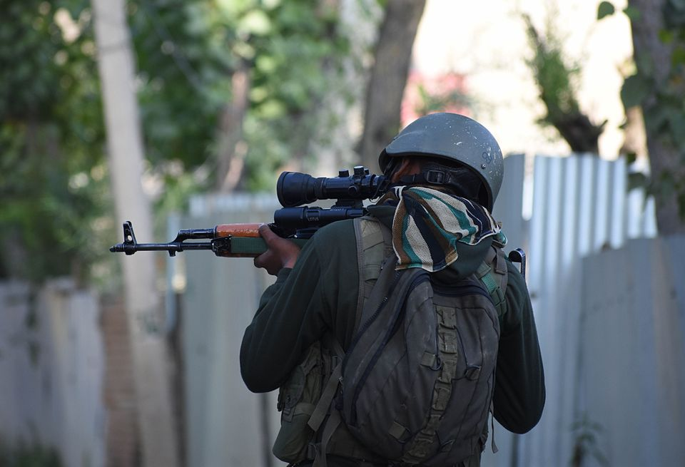 An Indian army soldier checks his rifle near the gun-battle site in Checkpora area of Budgam district...