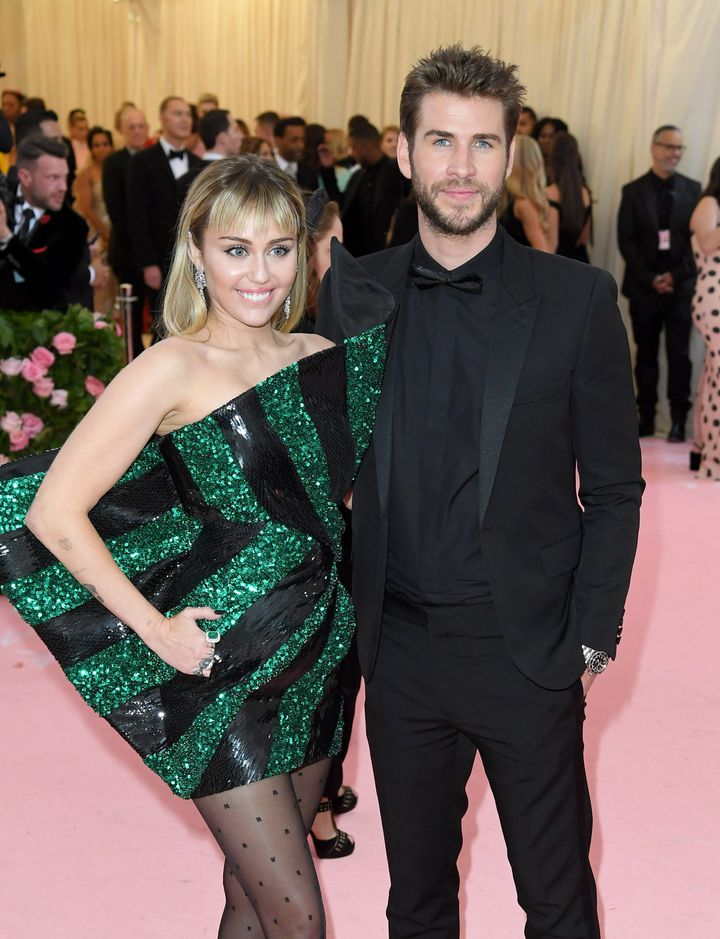 Miley Cyrus and Liam Hemsworth arrive for the 2019 Met Gala celebrating Camp: Notes on Fashion at the Metropolitan Museum of