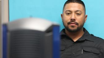 OREM, UT - JULY 09: A man has his photo taken at the Driver License Division for the state of Utah on July 9, 2019 in Orem, Utah. Documents recently made public show that the FBI and Immigration and Customs Enforcement (ICE) have made thousands of searches in Department of Motor Vehicle databases using facial recognition technology in at least three states including Utah, Vermont and Washington State. (Photo by George Frey/Getty Images)