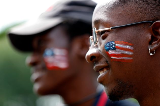 Asylum seekers from Angola attend a picnic for refugees, July 4, 2019, at Fort Williams Park in Cape...