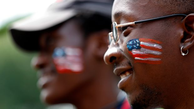 Alberto Claudio Konde, right, and Sebastian Mateus Miguel, asylum seekers from Angola, attend a picnic for refugees Thursday, July 4, 2019, at Fort Williams Park in Cape Elizabeth, Maine. Volunteers put together the welcoming picnic for asylum seekers housed at the Portland Expo. (AP Photo/Robert F. Bukaty)