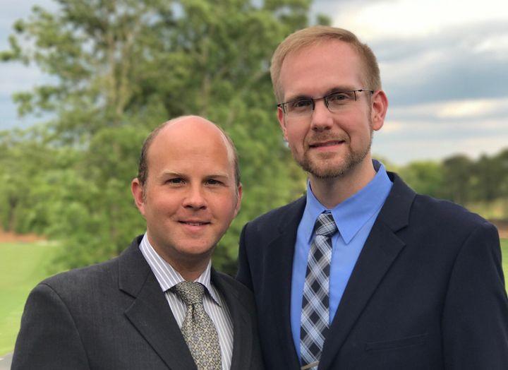 Joshua Payne-Elliott, right, and his husband, Layton Payne-Elliott, were both employed as Catholic school teachers in Indiana