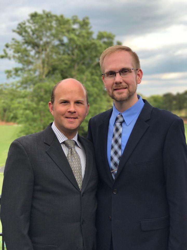 Joshua Payne-Elliott (right) and his husband, Layton Payne-Elliott, were both employed as Catholic school teachers in Indiana