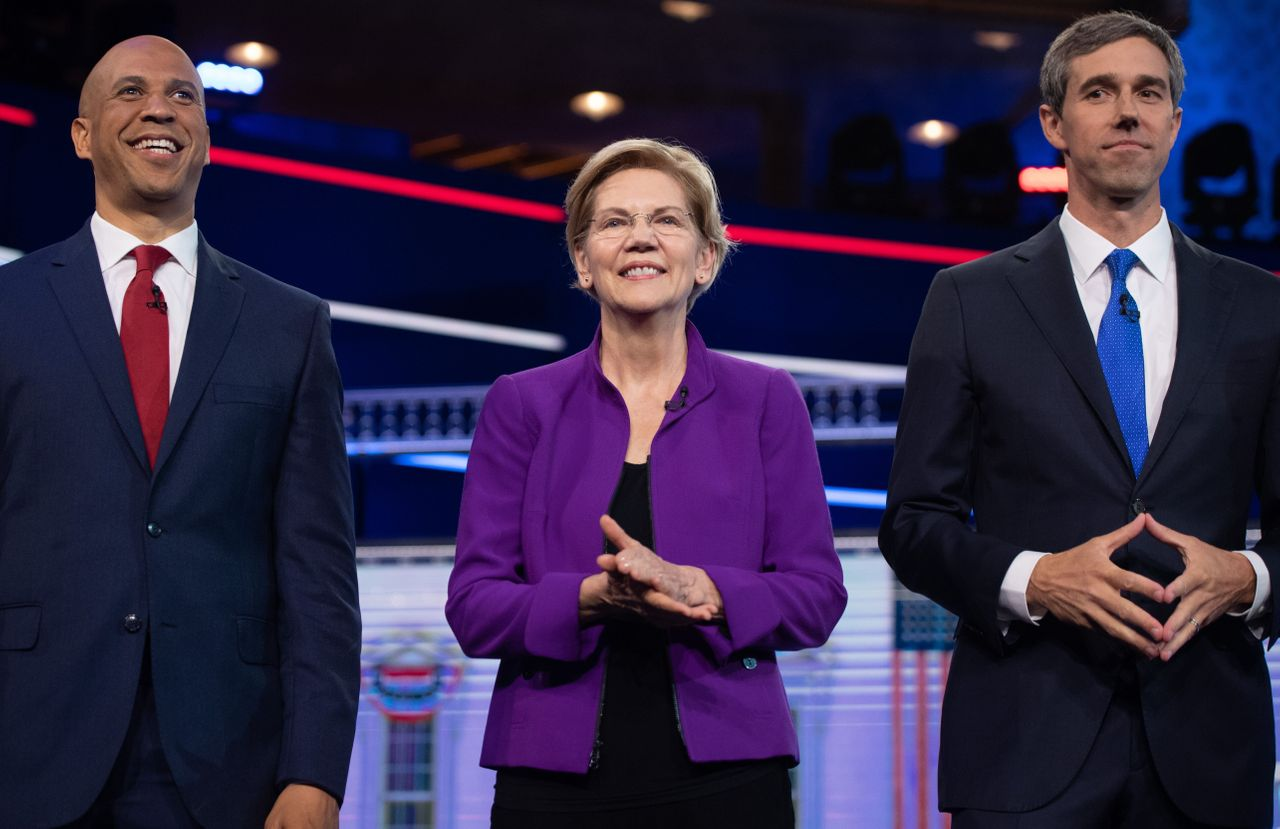 Warren with fellow candidates Sen. Cory Booker (N.J.), left, and former Rep. Beto O'Rourke (Texas) at the first Democratic Party presidential primary debate.
