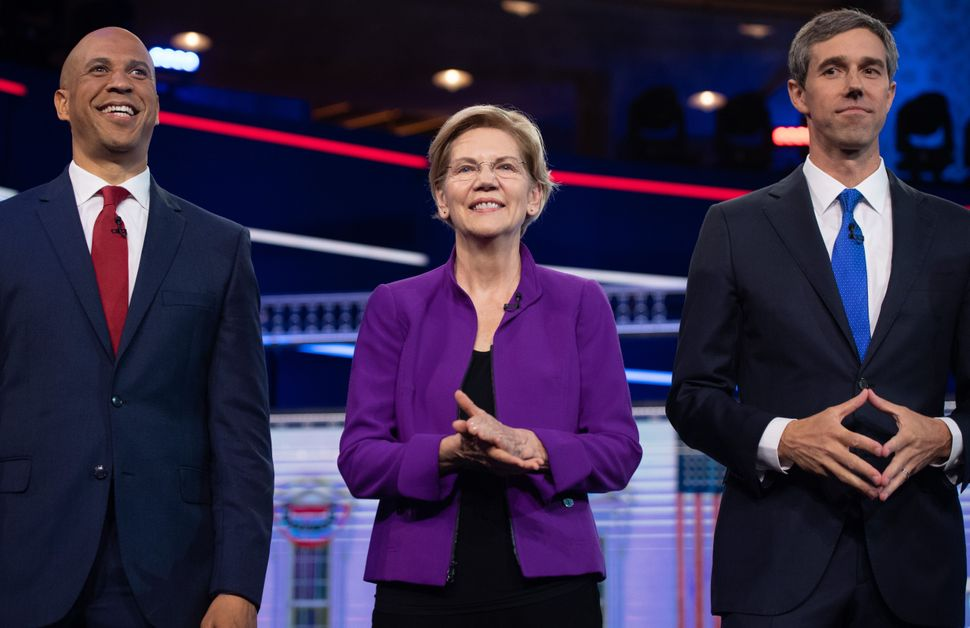 Warren with fellow candidates Sen. Cory Booker (N.J.), left, and former Rep. Beto O'Rourke (Texas) at the first Democratic Pa
