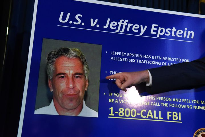 A prosecutor points to a photograph of Jeffrey Epstein at a July 2019 news conference in New York City.