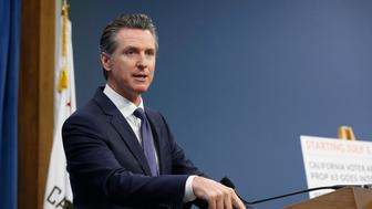 Gov. Gavin Newsom discusses a 2016 voter-approved ballot initiative that will require Californians to undergo criminal background checks every time they buy ammunition starting July 1 during a news conference in Sacramento, Calif., Tuesday June 25, 2019. (AP Photo/Rich Pedroncelli)